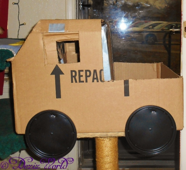 Side view of home made cardboard truck
