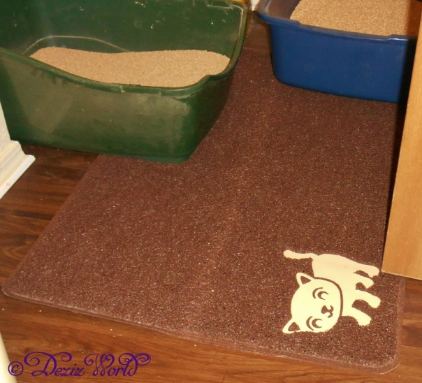 Smiling Paws Pets Litter Mat in Chocolate in front of litter boxes