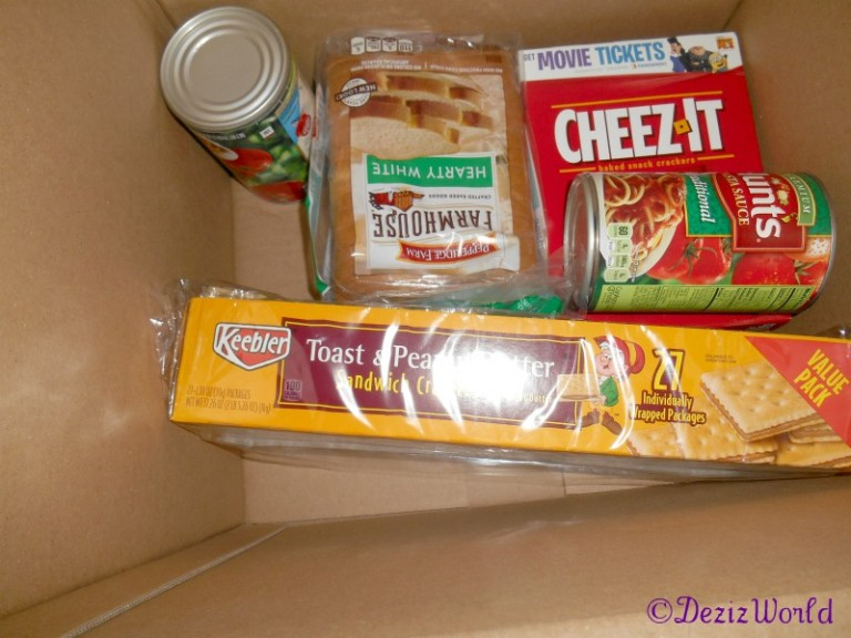 Gift box with cheez-it, bread, pb crakers, and pasta sauce