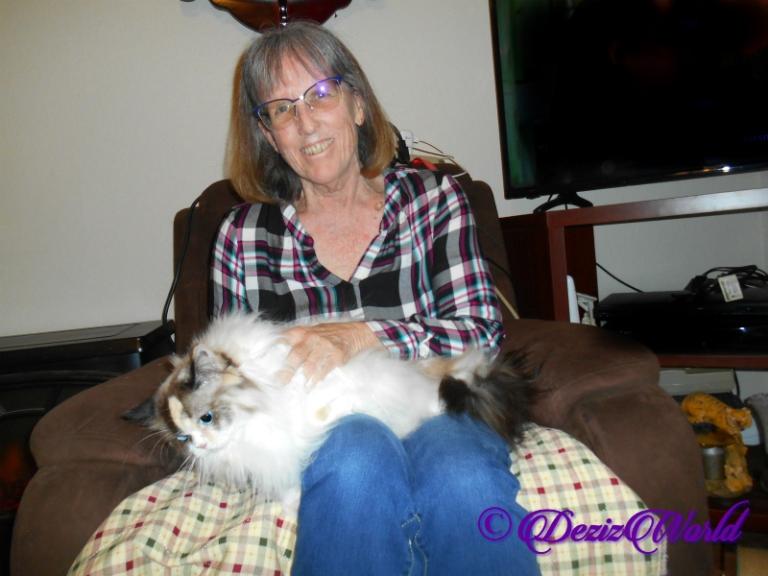 Raena lays in Ava's lap